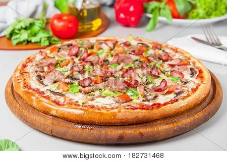Selective Focus Close Up Delicious Meat Pizza With Bacon And Sausages On The Wooden Board On The Kit