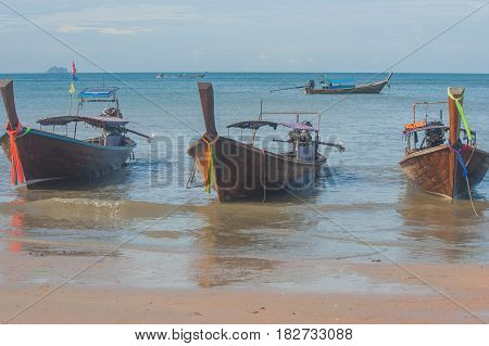Traditional long tail boat on Ao Nang Beach with blue sky background, Krabi, Thailand.