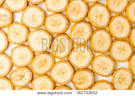 Background Of Sliced Banana Slices On White Table