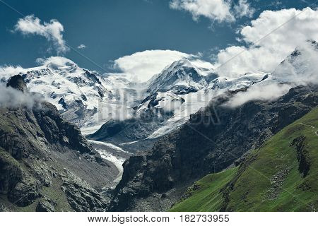 Snow capped alpine mountains. Trek near Matterhorn mount. View of the mountain and valley of a mountain river. Beautiful alpine landscape with a mountain path, Swiss Alps, Europe