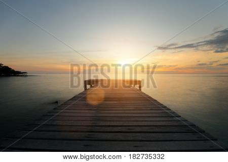 Wooden pier between sunset in Phuket Thailand. Summer Travel Vacation and Holiday concept.