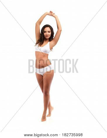 Young Brunette Woman With Tanned Skin And Curly Hair Standing In White Cotton Panties And Bra Isolat