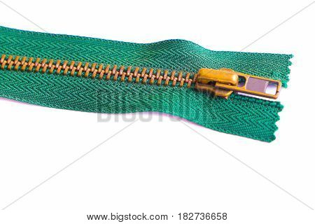 Close up green zipper isolated on white background