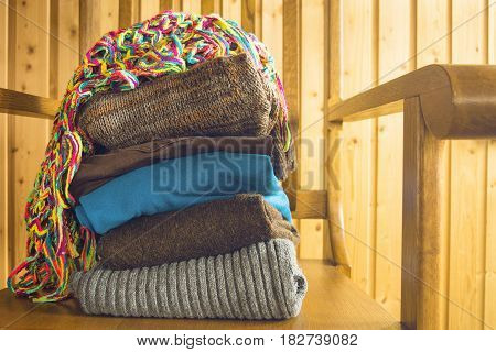 Stack of warm clothes ready for travel