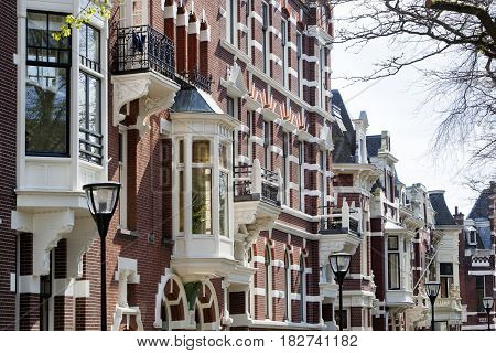 Street with historical houses in residential district Kralingen in Rotterdam in the Netherlands