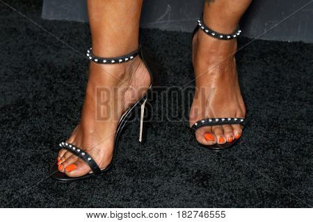 LOS ANGELES - APR 18:  Garcelle Beauvais (shoe detail) at the
