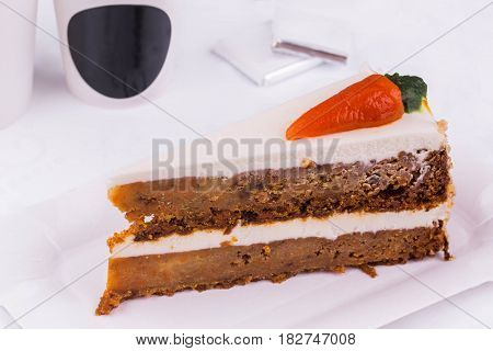 The carrot cake with addition of carrots, pineapple, walnut, raisin impregnated with butter cream