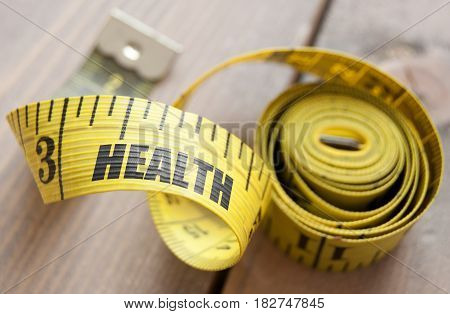 Close up of the word health printed on a tape measure