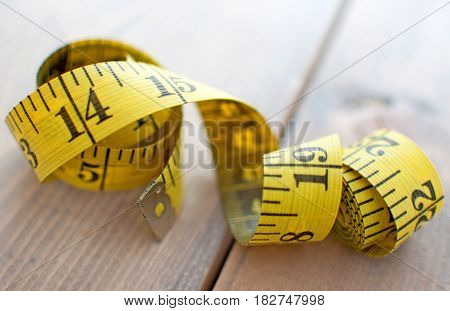Measuring tape close up on a wooden table