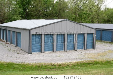 A building of self storage units with overhead doors.