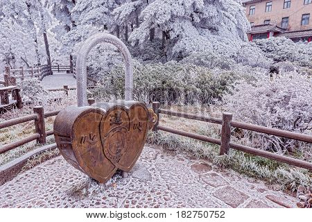 Huangshan mountain China - December 27 2016: Giant lock - symbol of love and wedding by the hotel.