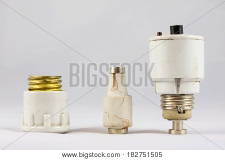 Old Ceramic Electric Fuses On White Isolated Background