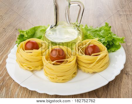 Dish With Vegetable Oil, Pasta Tagliatelle And  On Wooden Table