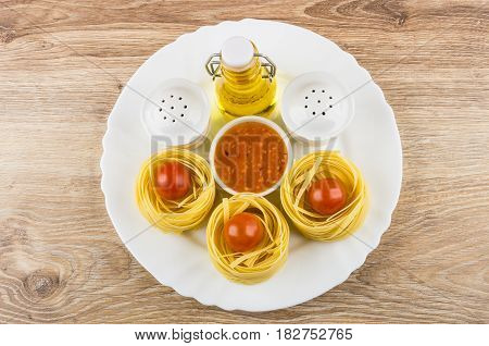 Dish With Vegetable Oil, Pasta Tagliatelle, Spices And Sauce