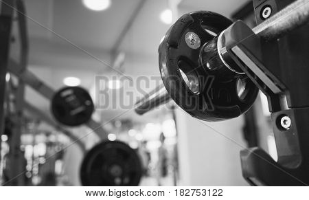 barbell with a weight of five kilograms for sports and exercises. Black and white photography.