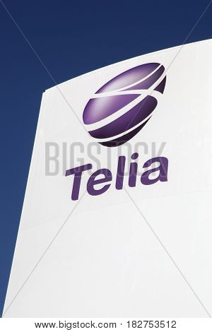 Odense, Denmark - April 9, 2017: Telia logo on a panel. Telia is the dominant telephone company and mobile network operator in Sweden and Finland