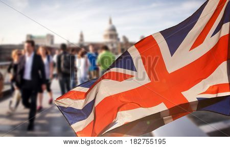 union jack flag and people walking on Millenium bridge in the background, London - UK prepares for elections after Brexit