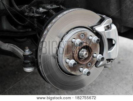Brake service inspection. Damaged brake disc and pads on classic vehicle