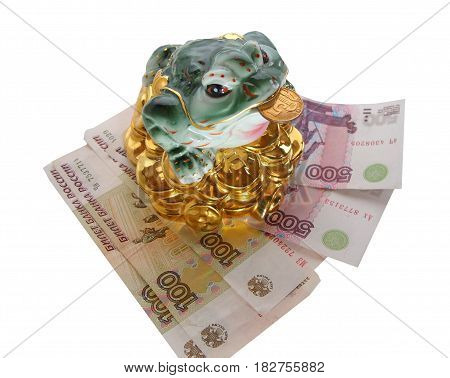 Chinese Feng Shui Frog with coins symbol of money and wealth is sitting on the banknote