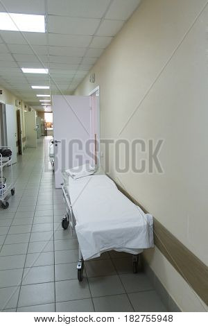 Photo of empty stretcher in hospital corridor