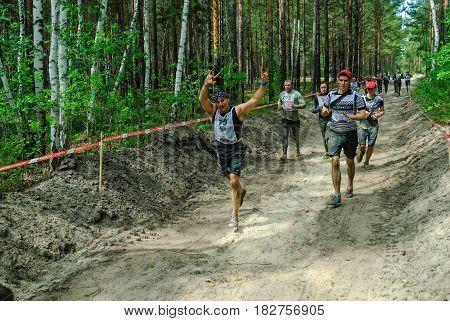 Sportsmen Run Between Stages In Extrim Race.tyumen