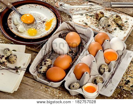Chicken And Quail Eggs On A Wooden Background.