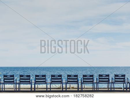 Promenade Des Anglais Seaside In Nice With Blue Chairs