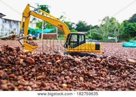 Excavator loader model on ground and are digging stone