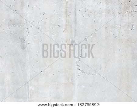Light gray concrete wall with a rough surface irregularities and slits