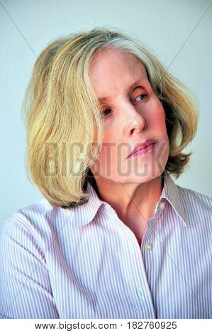 Mature female blond beauty fashion model expressions indoors.
