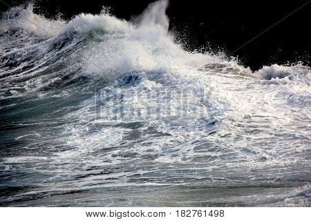 Force of raging waters against rocks in the caribbean.