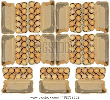 Eleven carton packages of ten brovn eggs isolated on white