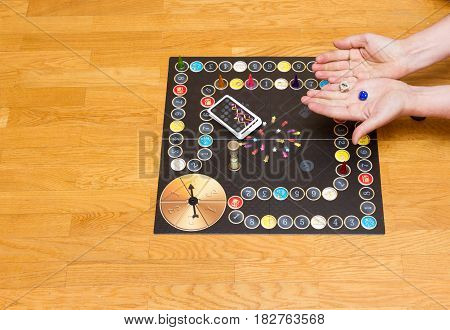 Board Game. Hand With Cubes