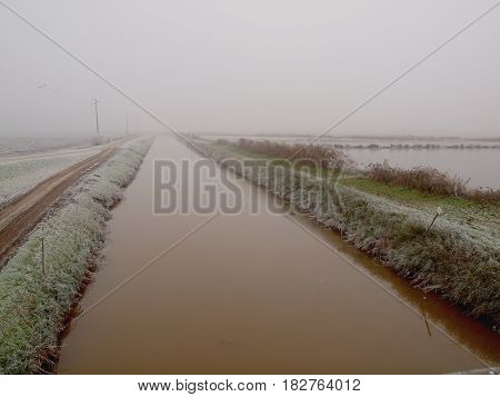 Ditch.  Winter landscape in the Italian countryside.