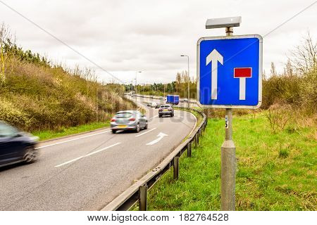 Day view background of UK Motorway Road Sign.