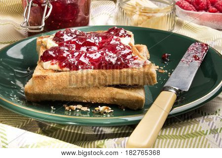 slice of scottish pub toast bread with home made raspberry jam