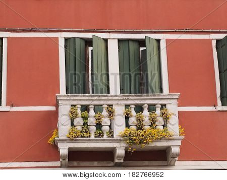 Chioggia, Italy. Two half-closed windows and an old balcony.