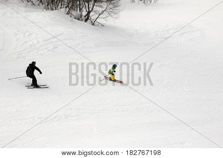 Skiers On Ski Slope At Winter Day