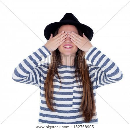 Smiling teenager girl with black hat covering her eyes isolated on a white background