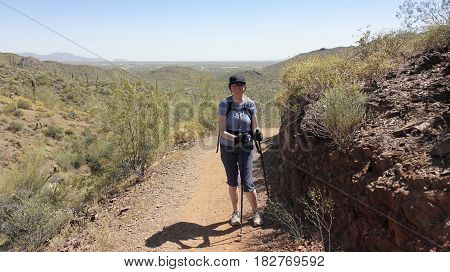 A Smiling Woman Pauses on the Go John Trail Cave Creek Regional Park Cave Creek Arizona