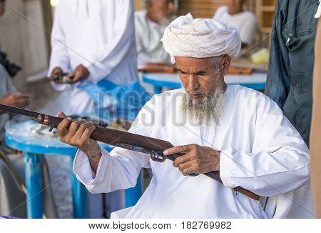 Omani Man Selling A Hunting Rifle At A Market
