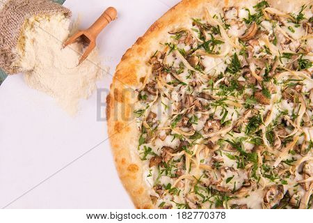 Pizza mushroom with champignons, oyster mushrooms and cepes with cheese sauce