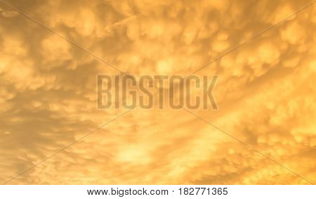 view of the fluffy orange clouds in the sky