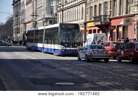 RIGA LATVIA - APRIL 13 2011: Traffic in the streets during the first warm days of spring.