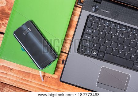 Flat Lay Lap Top Computer With Cup Of Coffee And Mobile Phone On