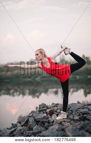 Young Girl Doing Yoga Fitness Exercise Outdoor Near River Landscape. Evening Sunset, Namaste Lotus P