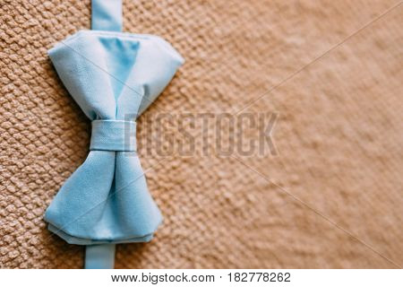 Tie Butterfly on a wooden background. Wedding in Montenegro