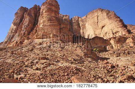 Red high rocks closeup. Wadi Rum valley in Jordan.