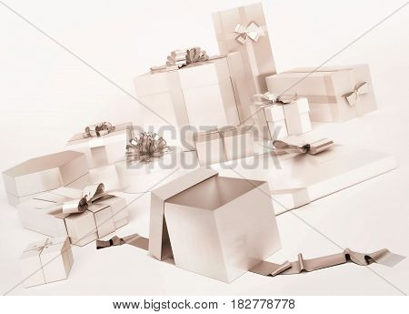 White gifts boxes with silver bows isolated on white background. 3D illustration