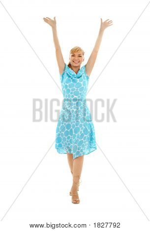 Happy Girl In Blue Dress With Hands Up